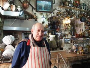 Abu Ashraf in his pancake restaurant