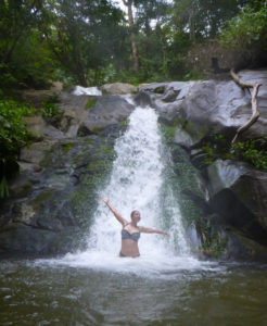 Swimming in a remote waterfall in the jungle