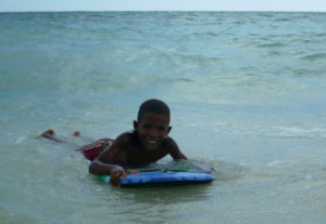 A local boy having a play with our body board