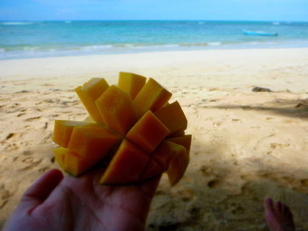Eating fresh mango on the beach, Playa de las Ballenas