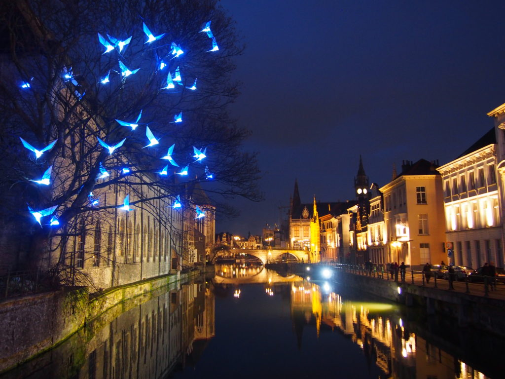 Reflections on the Leie Canal at night