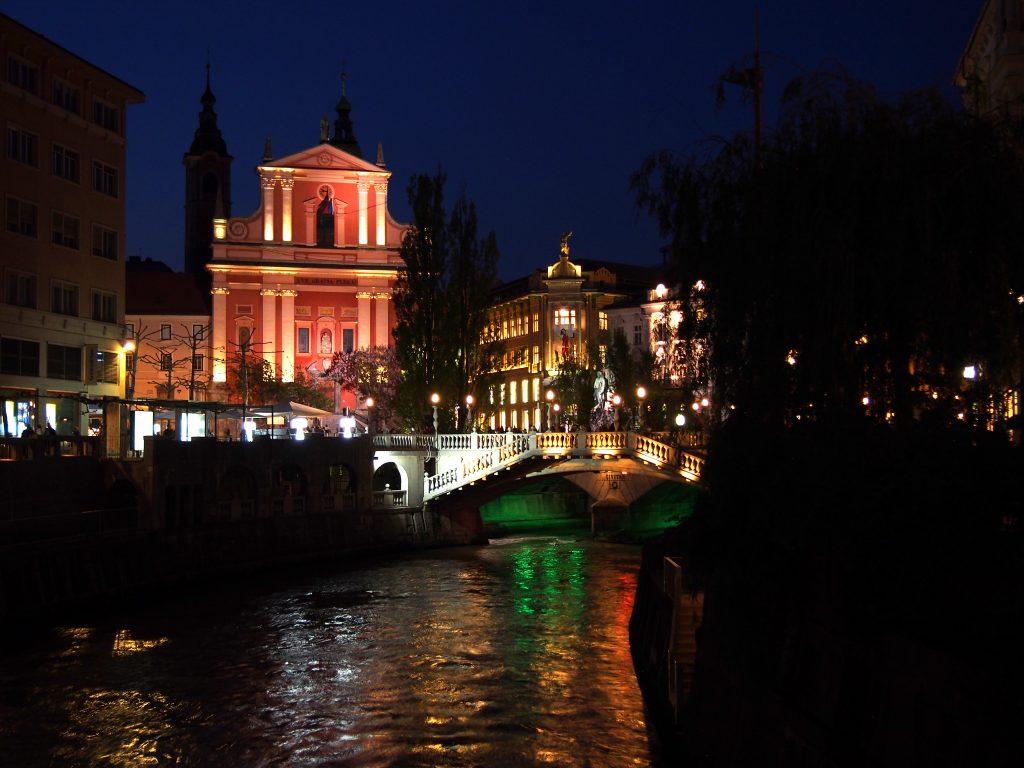 NIght photo of the Pink Church and Triple Bridge, Slovenia
